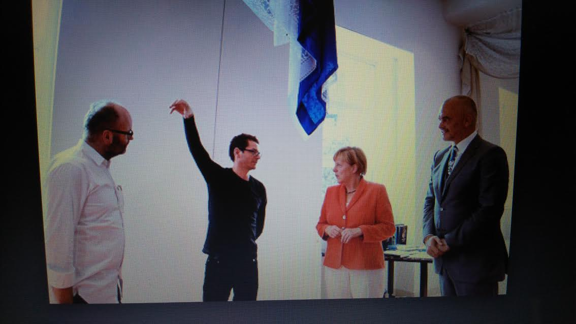 Artist Anri Sala (in black) speaks to Angela Merkel, Edi Rama, and Thomas Demand